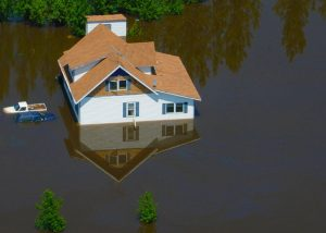 house surrounded by flood water